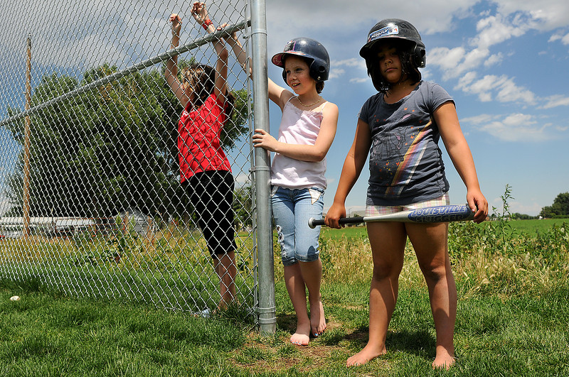 From left, Adeline Bowman, 10, Cameron Porter, 9, and Cassie Cordova, 9, of the Loveland Boys and Girls Club Angels practice for a game on Monday afternoon at the club. This is the first time a team has been organized to play other teams from the Boys and Girls Clubs in Fort Collins and Greeley.