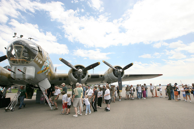 "People line up for a chance to walk through a  B-17 Flying Fortress named ""Nine-O-Nine"" Friday at the Fort Collins-Loveland Municipal Airport. The World War II era planes visited Loveland as a part of the Wings of Freedom tour."