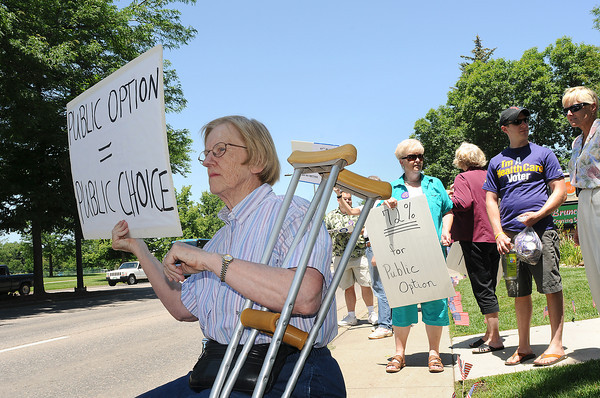 Georgia Locker of Fort Collins shows her support for a new type of healthcare during a rally Thursday at Sen. Michael Bennet's office in Fort Collins. Locker suffers from damaged cartilage in one of her knees and is undergoing an experimental treatment not covered my Medicare