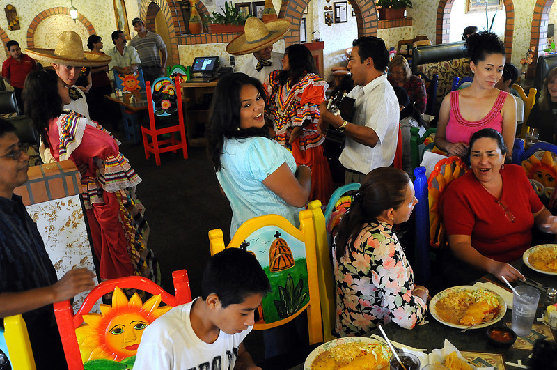 Dancers from Casa Hogar Los Angelitos and Casa de Cultura de Manzanillo perform at Guadalajara restaurant in Windsor on Tuesday. The group came to Northern Colorado with the Loveland group The Children's Foundation. The group was formed by Loveland resident Nancy Nystrom to help orphans.