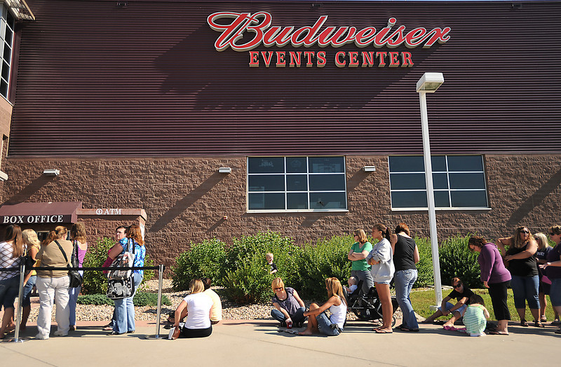 Women wait in line Friday for free tickets to see Billy Currington at the Budweiser Events Center at The Ranch. The concert, which is scheduled to take place on September 25 at the Budweiser Events Center was offering a special deal for the first 3,500 females to show up at one of three locations were able to recieve free tickets.
