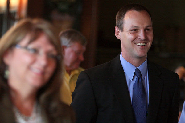 State Senator Josh Penry is surrounded by supporters as he is introduced to speak Tuesday morning at Harmony Grill in Fort Collins.  Penry has announced he will be running for Governor in 2010.