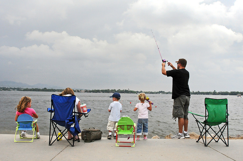 The Stroup family of Erie tries to get a bite as they fish Lake Loveland on Sunday at the South Shore Parkway. From left are Samantha, 6, Nicole, Riggs, 3, Emerson, 3, and Eric Stroup. The kids just got new poles so the family made the trip north to try them out.