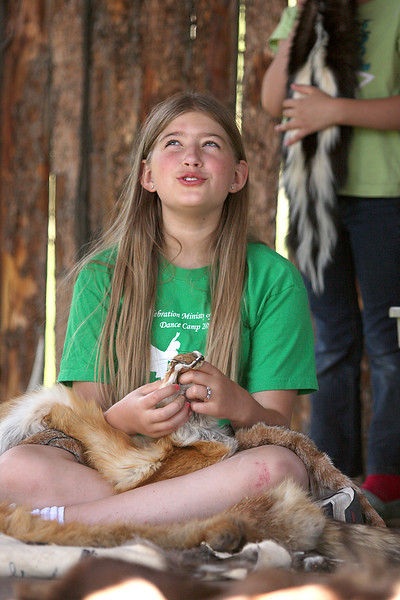 Kianna Peters, 10, from Fort Collins, holds a red fox pelt while surrounded by other animal skins native to the Lory State Park Tuesday during the park's Junior Ranger Adventure Program.