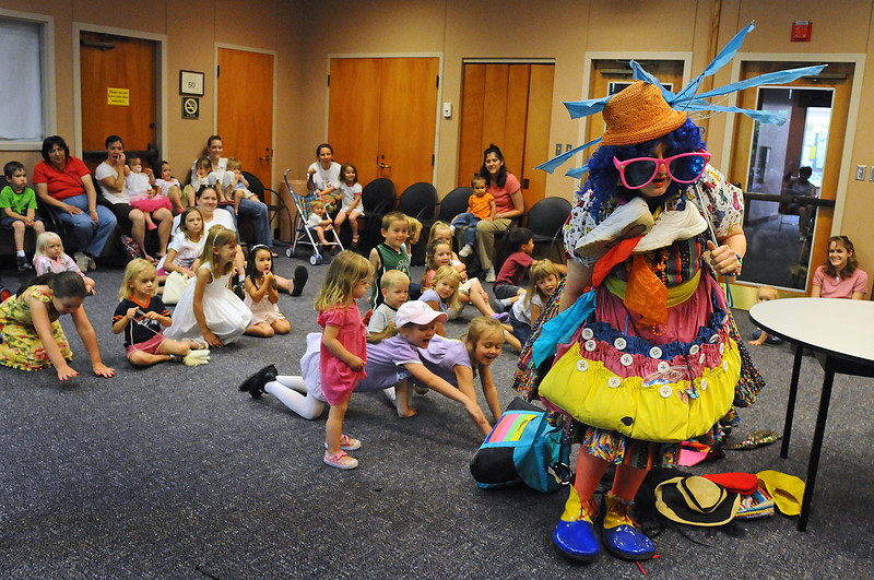 "Golden's Cheri Seeton, known as ""Merry Cheri the Clown"" entertains the kids on Monday morning during a Monday Morning Family Fun Program at the Loveland Public Library. The library will hold similar events every Monday. For more information call Youth Services at 962-2587 or visit their website at lovelandpubliclibrary.org."