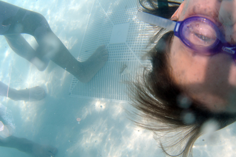 Karly Mill, 12, swims by a filter cover in the leisure pool at Winona Pool on Wednesday afternoon. The new pyramid-shaped covers have been installed at the pool in compliance with a federal law to protect children from getting trapped against them.