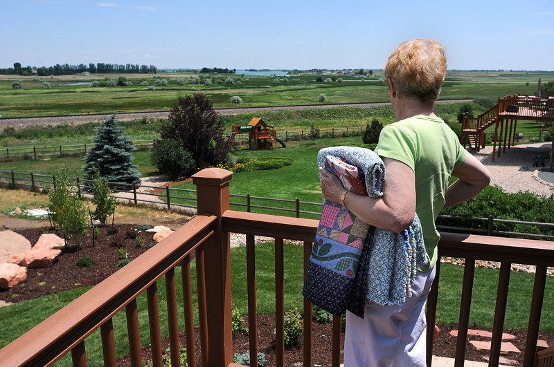 Ann Eatman of Project Hero Quilts looks out over the backyard of disabled Iraq War veteran John Jones as she prepares to present the veteran with quilts on Thursday.