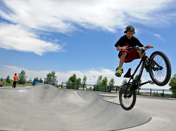 Loveland resident Jake Anderson, 12, catches some hang time on his bike at Loveland Sports Park on Sunday. Jake is trying to get the most out of summer before it ends by coming to the park multiple times a week.