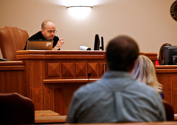 Magistrate Matthew Zehe asks defendant Daniel Ortiz (not pictured) questions concerning his DUI offense on Friday, July 2 during the first case heard by the newly formed Larimer County DUI court at the Larimer County Justice Center in Fort Collins.