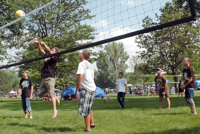 Fourth of July revelers play a game of volleyball Sunday at North Lake Park while enjoying the park with others prior to the nighttime fireworks display. From left are Ryan Albert, Dylan Tippman, Nathan Lewis, Terry Walston, Eli Tippman and Tanner Weickum.