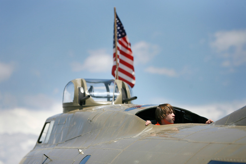 Loveland resident, Kenny Miller, 15, peeks his head out of a B-17 bomber during the Wings of Freedom Tour on Sunday at the Loveland Airport.