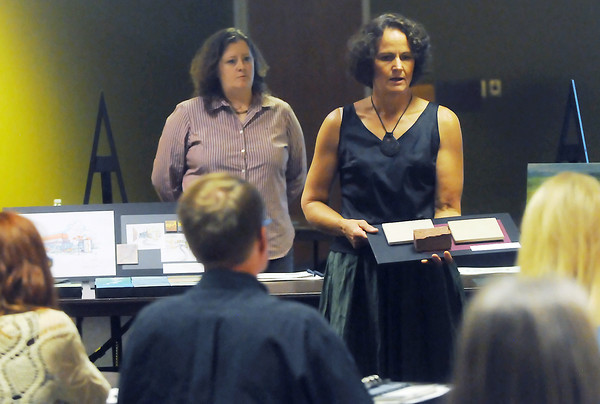 Alyson Kinkade, back left, and Kathleen Caricof give a presentation to the Loveland Visual Art Commission during a meeting with finalists for the library expansion project.