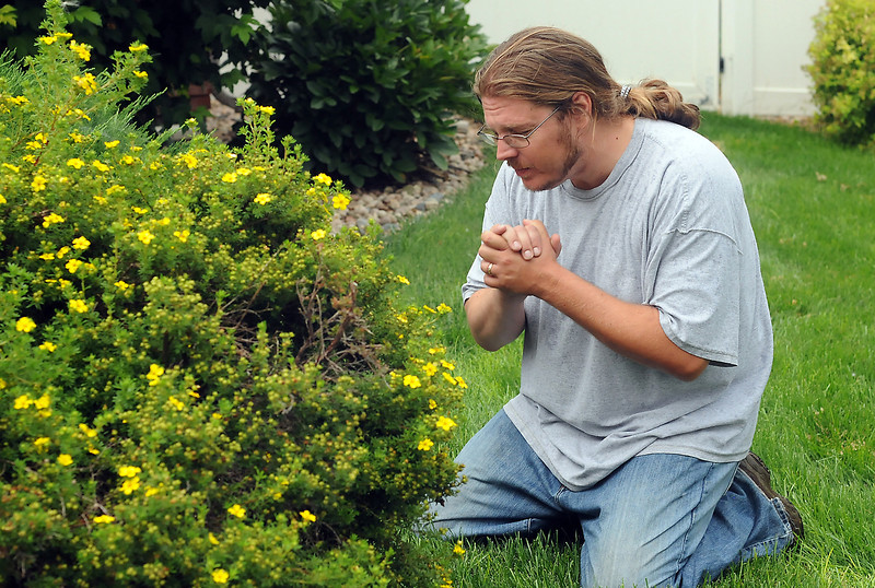 "Neil Forsythe portrays Jesus in the garden from a scene in the play ""Godspell"" while at a rehearsal Wednesday evening in south Loveland."