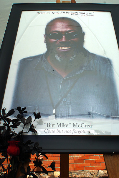 "A memorial display at the Loveland Loves Barbecue event Saturday featured a picture of ""Big Mike"" McCrea."