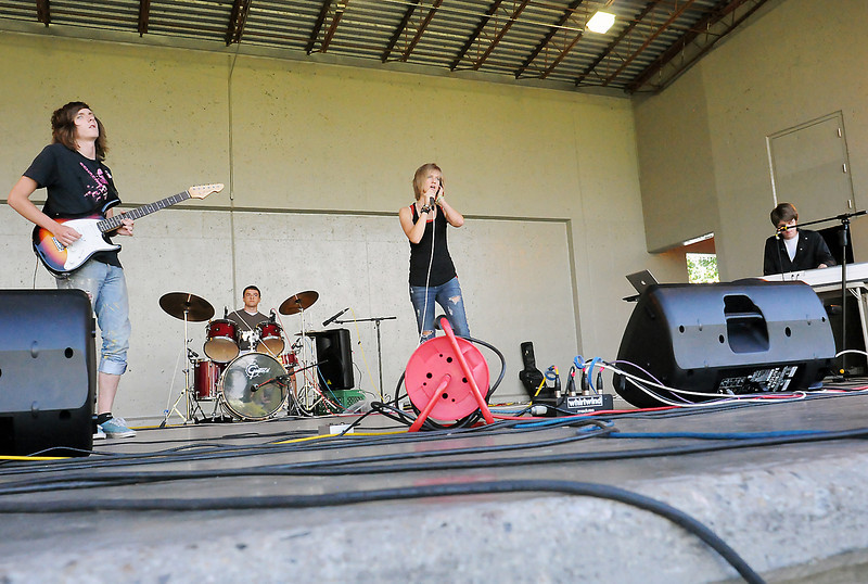 "Members of the band ""80HD"" perform during the Battle of the Bands on Wednesday, July 21, 2010 at the Hammond Amphitheater. From left are Hunter Weitz, 16, Lucas Suazo, 17, Katie Wetzel, 17, and Connor Weitz, 17."