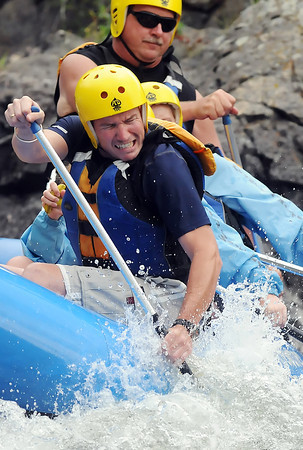 New Jersey resident Gary Brooks, front, paddles through some rapids while on a rafting trip with others on the Poudre River northwest of Fort Collins on Wednesday, July 21, 2010 with outfitter Mountain Whitewater Descents.
