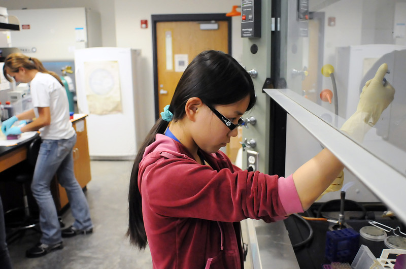 Loveland High School senior Xiaoye Wang, 17, right, and Cassia Kent, 17, a senior from Kit Carson High School, work in Dr. Keenan's lab Tuesday in Ross Hall at the University of Northern Colorado while taking part in the Frontier Science Institute.