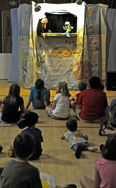 Dozens of children are   watching a puppet show about the Big Thompson River at Garfield Elementary School in Loveland.H2O Joe and other river animals informed children how polluted water and overuse can impact river life. The puppet show was put on after children had eaten lunch in conjunction with the summer foods program.