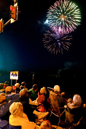 Spectators at the intersection of 22nd Street and Taft Avenue watch was fireworks burst over Lake Loveland on Monday night. The fireworks display was postponed after heavy rains forced many to cancel Fourth of July plans Sunday.