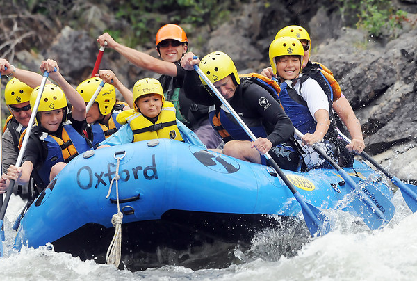 Mountain Whitewater Descents river guide Trevor Melton, back center, negotiates some rapids as he takes a group of rafters on a trip down the Poudre River northwest of Fort Collins on Wednesday, July 21, 2010.