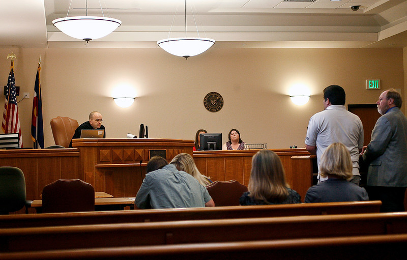 Magistrate Matthew Zehe, far left, asks defendant Daniel Ortiz questions concerning his DUI offense on Friday, July 2 during the first case heard by the newly formed Larimer County DUI court at the Larimer County Justice Center in Fort Collins.