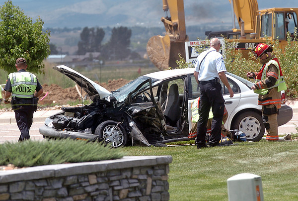 Emergency personnel work the scene of an accident Wednesday afternoon at the intersection of East US 34 and Larimer Parkway.