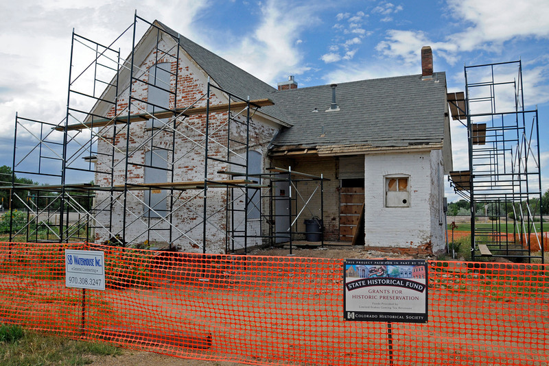 City planners hope to preserve the Milner Schwartz house at Fairground Park if they can get a state historic grant. Crews were already at work on the outside of the house on Thursday.