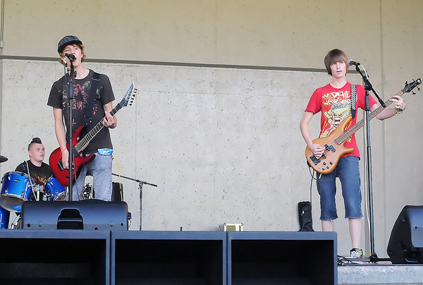 "Members of the band ""Social Outcast,"" from left, Chris Wohlleben, 16, Alex Copher, 15, and Dalton Carney, 16, perform during the Battle of the Bands competition on Wednesday, July 21, 2010 at the Hammond Amphitheater. Not pictured is guitar player Collin Cross, 16."