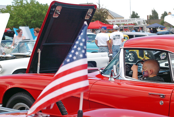 Four-year-old Aidan Koenig sits behind the wheel of his grandfather Fred Koenig's 1962 Chevrolet Corvette during the All American Car Show on Saturday, July 3, 2010 at the Outlets at Loveland. Aidan is from Norco, Calif. and was attending his first car show while in Loveland visiting his grandparents.