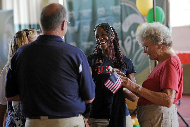 US Olympic track team member Janay DeLoach, middle, greets well wishers at the Glenn Morris Field House on the Colorado State campus in Fort Collins during a send-off party Friday for her trip to London to compete in the long jump event.