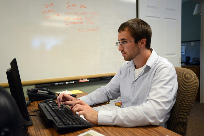 United Way 2-1-1 call specialist Logan Jones works at the call center in Fort Collins on Tuesday, July 24, 2012.