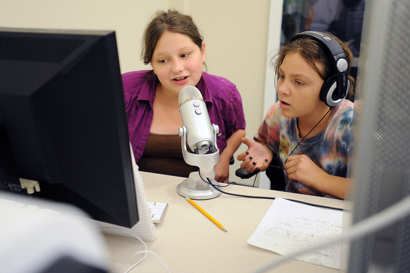 Sierra Place, 12, left, and Makenna Remus, 10, record a song Wednesday, July 11, 2012 on a computer in the Loveland Public Library's iCreate Lab that Sierra wrote. The lab has two multi-media computers with a variety of software for working on things like pictures, videos and audio projects.