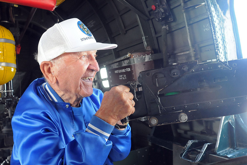 World War II vet John Mihalek plays with a machine gun on the Consolidated B-24 Liberator on Friday morning. Mihalek was a nose gunner on a B-24 Bomber in WWII. The Consolidated B-24 Liberator is one of three WII aircraft on display this weekend at the Fort Collins-Loveland Municipal Airport.