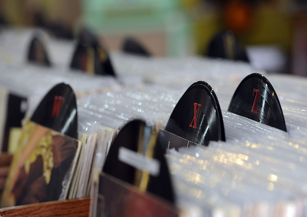 Vintage vinyl records mark sections at Loveland's new record store, Downtown Sound.
