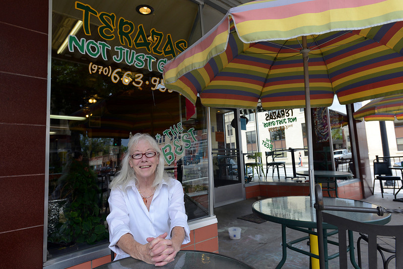 Terazas Not Just Gyros owner Terry Madigan poses outside her restaurant in downtown Loveland at 141 E. Fourth St. on Friday, July 27, 2012.