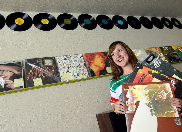 Lizz Roth holds some of her favorite vinyl records Tuesday at Downtown Sound, a new store that sells and repairs vinyl records, turntables, guitars, amplifiers and more opened Tuesday and is co-owned by Roth and her parents Veronica and Ed Roth.
