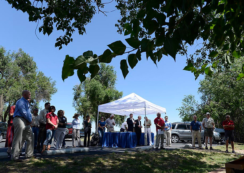 People gather at The River Bluffs Open Space Tuesday in Windsor for a celebration for the county receiving a $5.1 million GoCo grant to complete the Poudre River Trail.