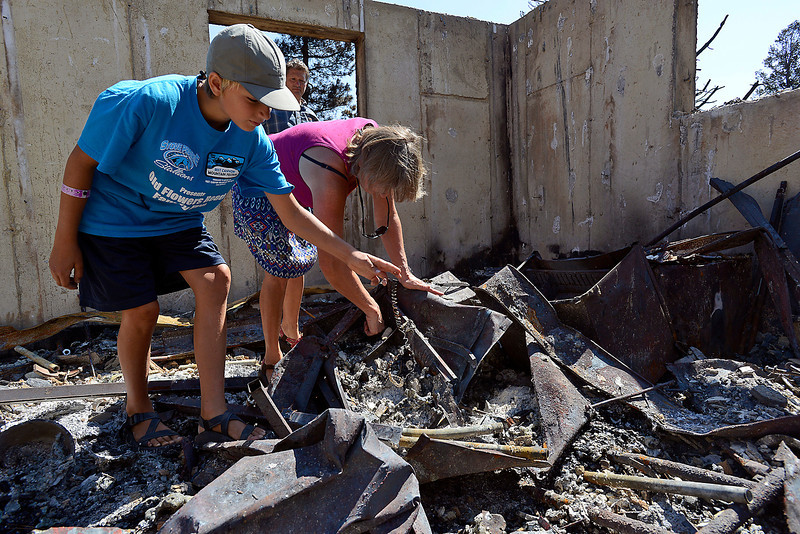 Linda Squibb and Dakota Squibb, 11, go through charred rubble looking for sentimental items in the remains of their home burned in the High Park fire.