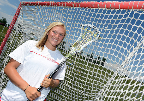 Maggie Mawhinney poses for a photo at The Loveland Sports Park Monday. She coaches lacrosse for the Mile High Elite, a club she helped form to give kids another option to play.