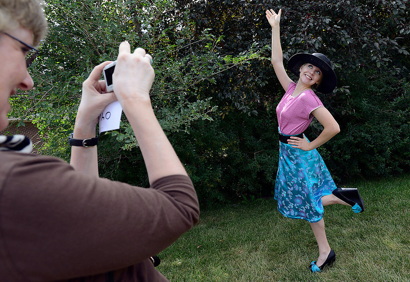Patty Roberts of Berthoud, 16, hams it up for the camera as her mom Debbie Crans, left, takes photos of her in one the outfits she wore for the style your own category during the Larimer County Fair 4-H Fashion Revue Wednesday at the Life Pointe Church in Fort Collins.