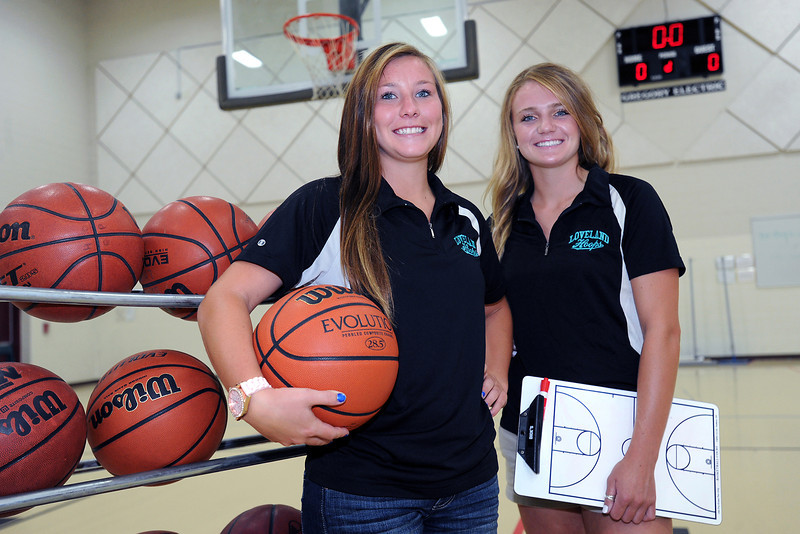 Basketball coaches Colissa Bakovich, left, and Addie Coldiron pose together in the gymnasium at Irwin Middle School on Tuesday, July 17, 2012.