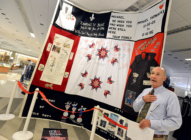 Jeff Basinger, head of the Northern Colorado AIDS Project, tells employees at Macy's department store in Loveland about a section of the AIDS Memorial Quilt that is on display at their store Thursday. It will be on display for about a week leading up to the Coloraod AIDS walk. It is the first time in 19 years the quilt has been opened and the first time a section of the quilt has been displayed in Loveland.