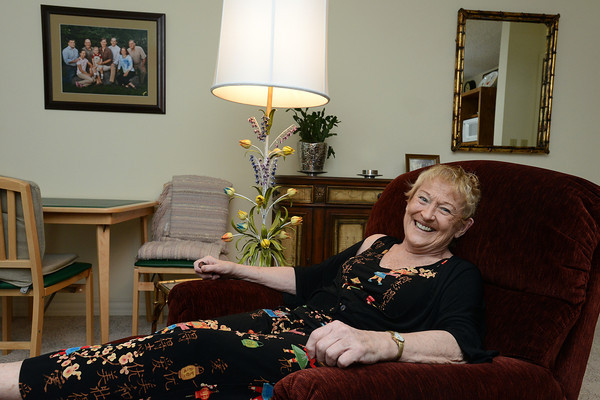 Margie Spanier poses in her home at Good Samaritan Loveland Village on Thursday afternoon.