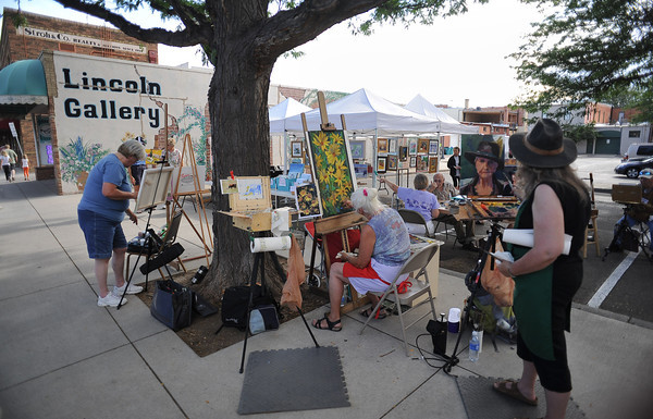Lincoln Gallery artists, from right, Jenifer Cline of Loveland, Diane Wood of Boulder County and Sandy Davidson of Loveland create during the Cherry Pie Celebration at Peters Park on Saturday afternoon.<br /> <br /> Note: Jenifer is the correct spelling.