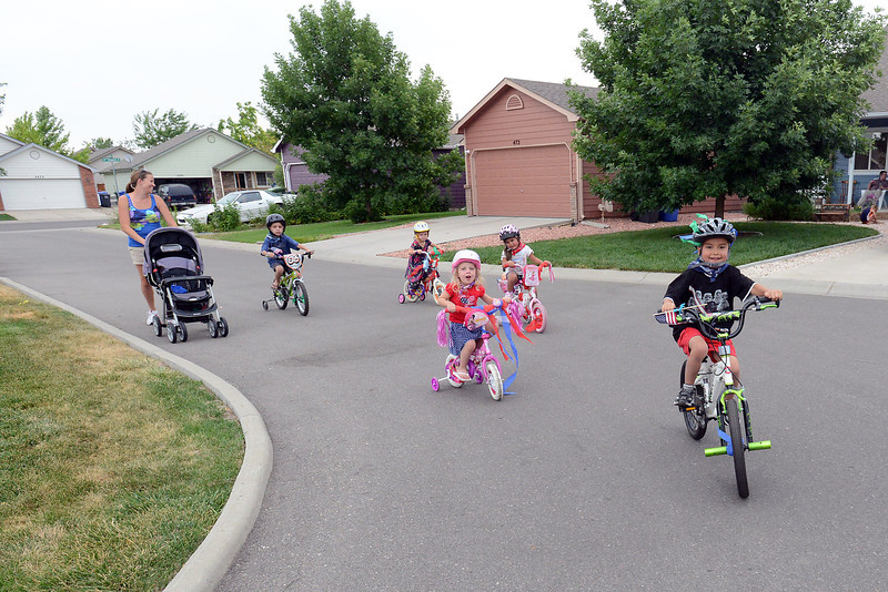 Youngsters ride around on their bicycles decorated with streamers and American flags during their Red, White and Blue Bike Parade around their neighborhood in Loveland on Tuesday, July 3, 2012. From left are Robin Flores, Kaleb Spadafora, 5, Madeline Clark, 4, Delia Spadafora, 3, Gabriella Flores, 4, and Isaac Flores, 6.