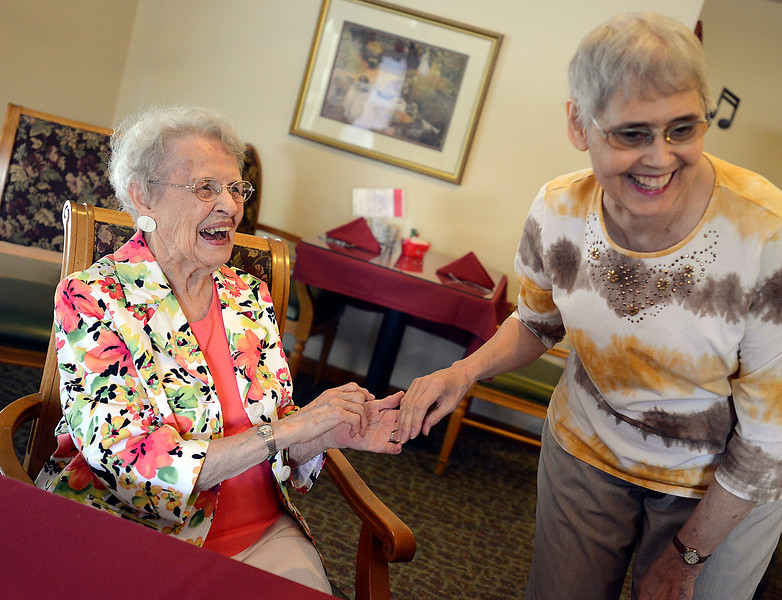 "Celebrating her 102nd birthday, Herdes Berquist, left, shares a laugh with Rose Christensen, who said ""I was asking her for some longevity secrets."" Berquist celebrated with friends and family Thursday at The Sterling House in Loveland."