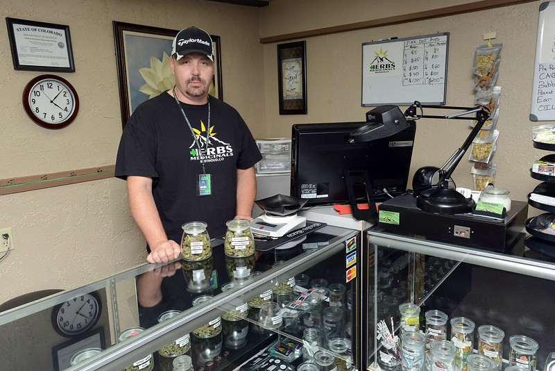 Herb's Medicinals owner Kevin Ballinger poses Friday, July 7, 2012 in one of the dispensary rooms in the business located at 435 Mountain Ave. in Berthoud.