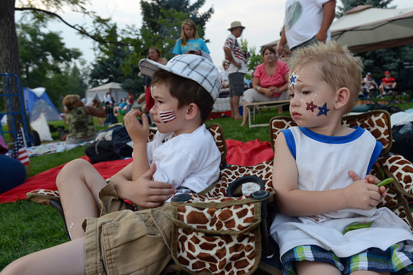 Josh Gischel, 6, left, and his brother Jack, 3, sit together at North Lake Park on Wednesday, July 4, 2012 while waiting for the annual fireworks display over Lake Loveland to begin.