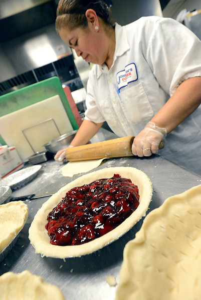 Esther Bejarno makes cherry pies Tuesday in the kitchen at Johnson's Corner. Folks at Johnson's Corner will be making 275 cherry pies for this weekend's Cherry Pie Celebration in downtown Loveland.