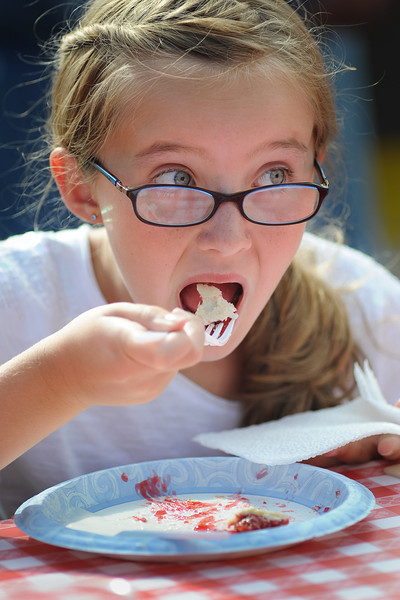 Caroline Vacante, 11, of Fort Collins scrapes up the last bite of her cherry pie on Saturday afternoon during the Cherry Pie Celebration at Peters Park.